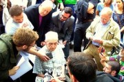 Daniel Berrigan speaks to the press at Zuccotti Park. Above him, Bishop George Packard, and to the right of him, Chris Hedges. Photo by Loren Hart.