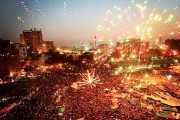 Fireworks burst over crowds dancing and waving flags in Cairo's Tahrir Square after news of President Morsi's ouster. (Flickr / samataa)