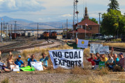 The 14 protesters who shut down the main coal export rail line to the West Coast pose before being arrested. (WNV / Jeff Vantine)