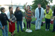 Artist Rachel Schragis leads a group of climate activists in a song about unity. (Youtube still / Owen Crowley)