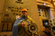 An activist stands with a bullhorn outside Kiev's City Council, which was taken over by the opposition on December 1, 2013. (Flickr/Ivan Bandura)
