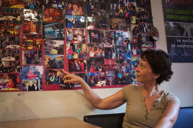Eleftheria Farantaki pointing out photos from the collage of ERT3's first year of occupation. (WNV/Kirsten Han)